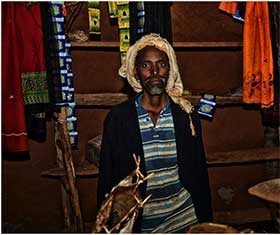 Yusuf Abdi Farrah within his shop