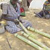 A HSNP beneficiary engaging in making of brooms for selling, Turkana