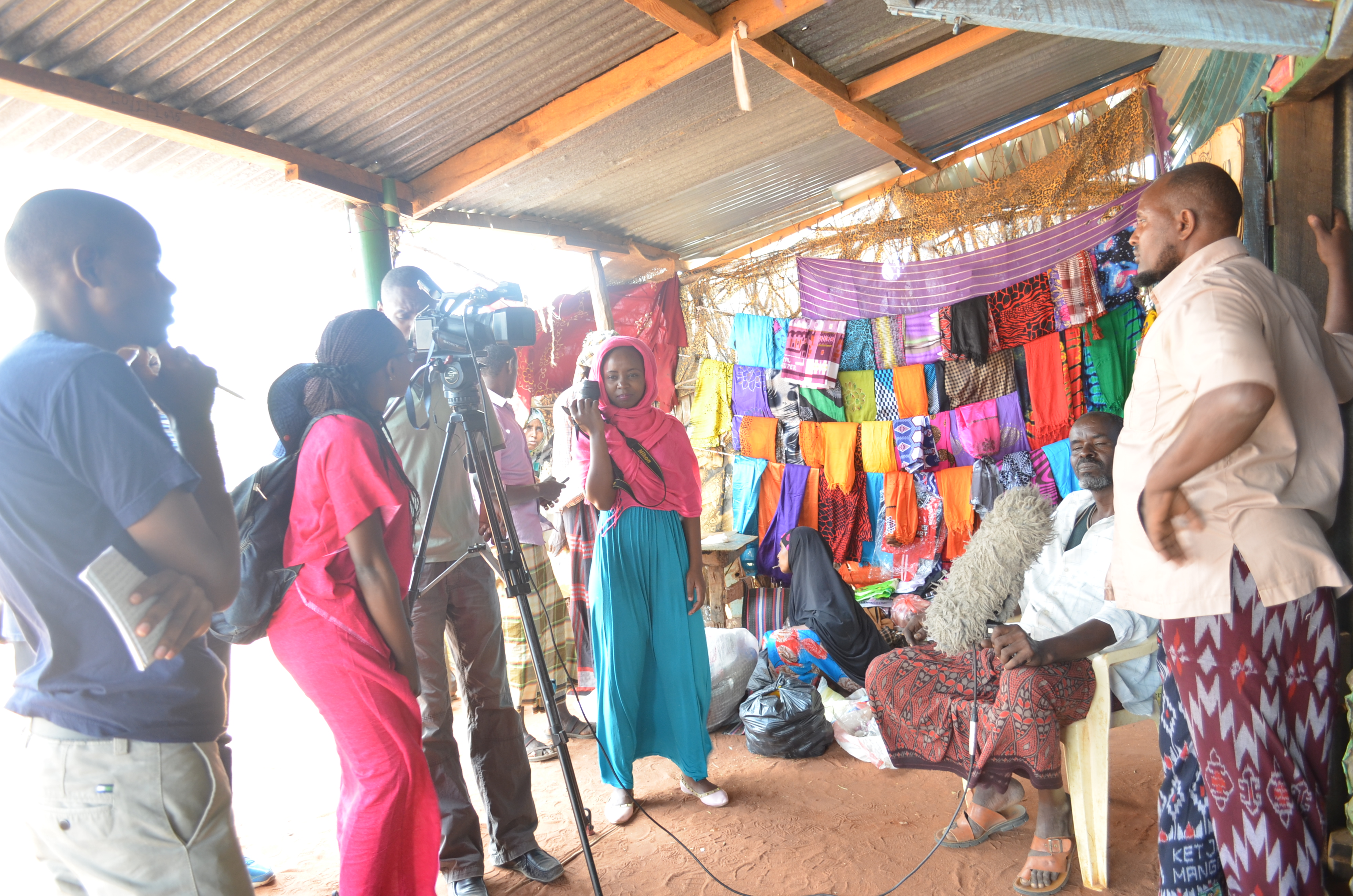Journalists from NTV, K24 and the Standard interviewing a HSNP beneficiary from Wagalla, Wajir